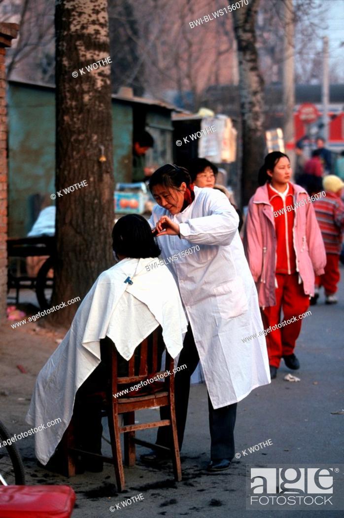 Stock Photo: barber in a street of Beijing, China, Beijing.