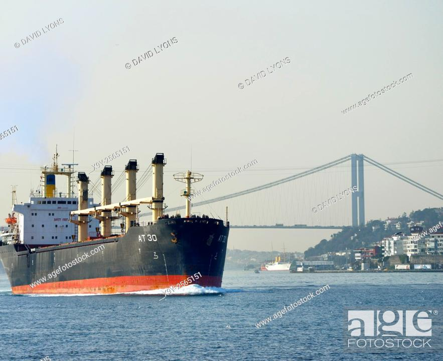 Stock Photo: Togo flagged bulk carrier AT 30 leaves the First Bosphorus Bridge, Istanbul, northbound on the Bosphorus, Turkey.