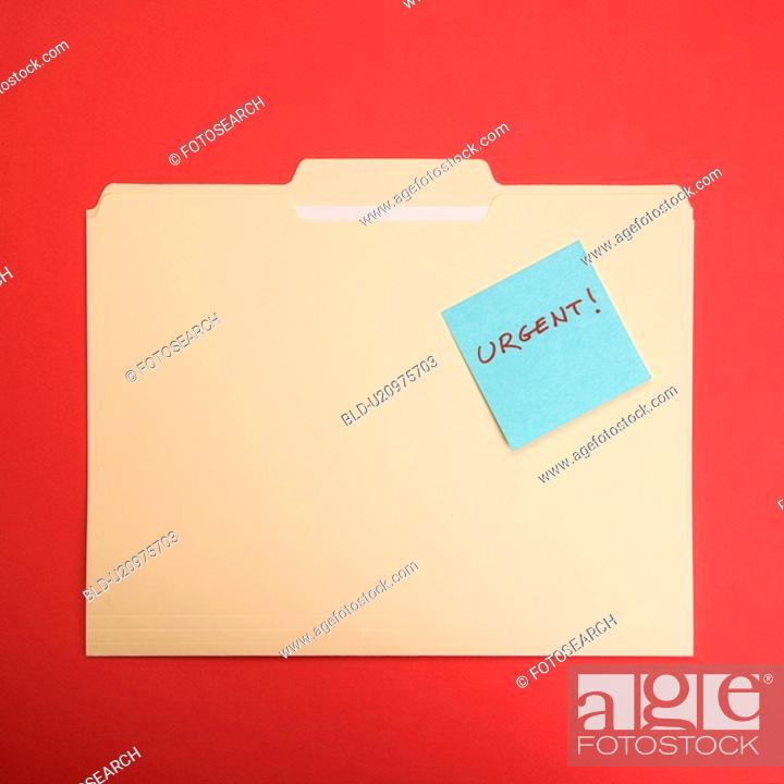 Stock Photo: Folder with a sticky note attached reading urgent on a red background.