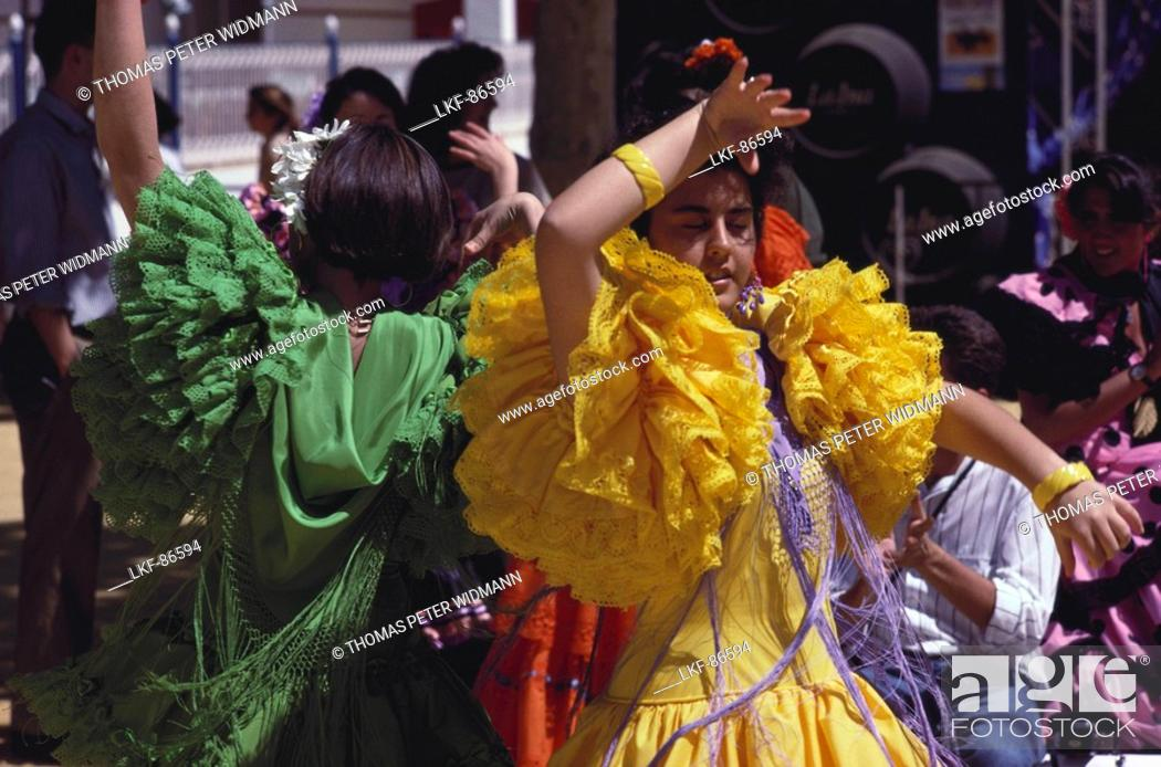 Stock Photo: Young women in colourful frilly dresses dance Flamenco, Jerez de la Frontera, Cadiz province, Andalusia, Spain.