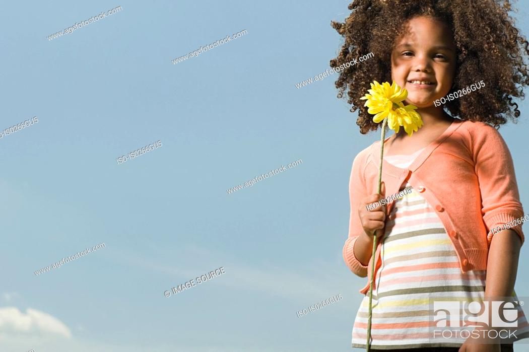 Stock Photo: Girl with a flower.