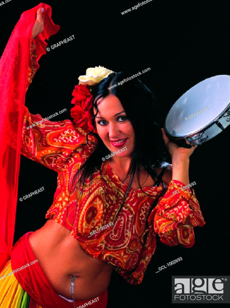 Stock Photo: belly dancer with a tambourine.