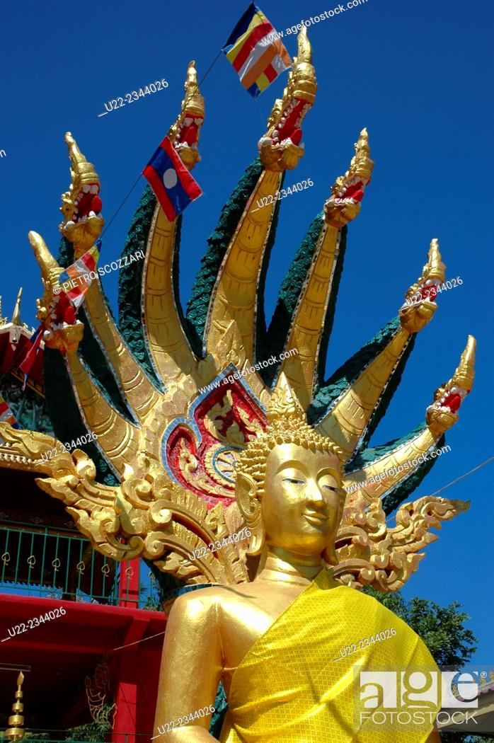 Stock Photo: Vientiane, Laos: Buddha statue in a temple.
