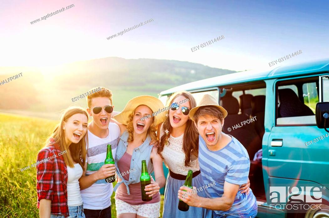 Stock Photo: Young hipster friends on road trip on a summers day.
