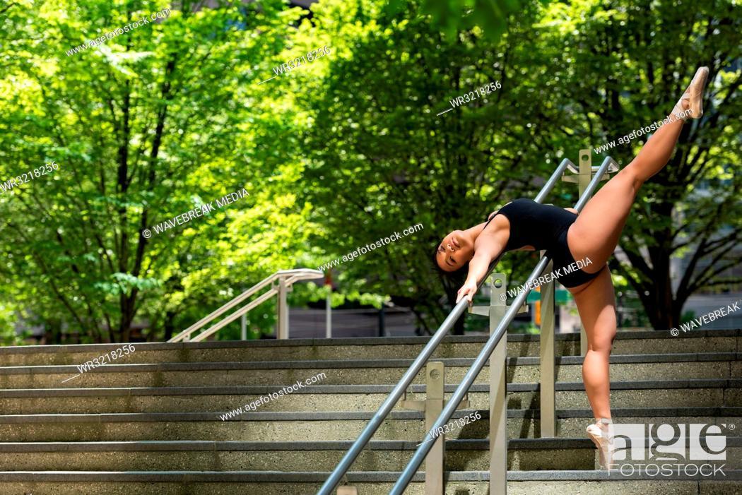 Stock Photo: Female ballet dancer dancing on the steps.
