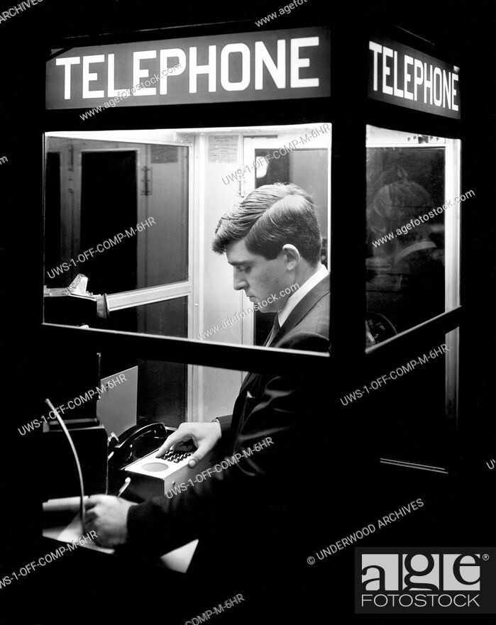Stock Photo: Boston, Massachusetts: c. 1968.This man now has 24 hour access, even from a telephone booth, to a remote computer with the Honeywell Electronic Data Processing.