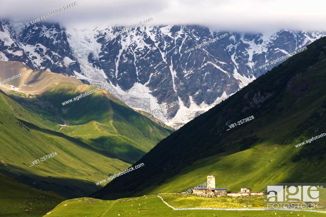 Stock Photo: Lamaria church and tower in huge Caucasus mountains background. Ushguli, the highest permanently inhabited village in Europe. Svaneti, Georgia.