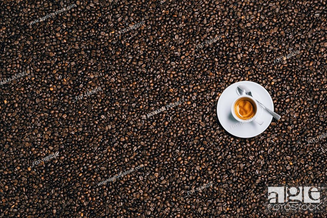 Stock Photo: Directly above shot of espresso cup on roasted coffee beans.