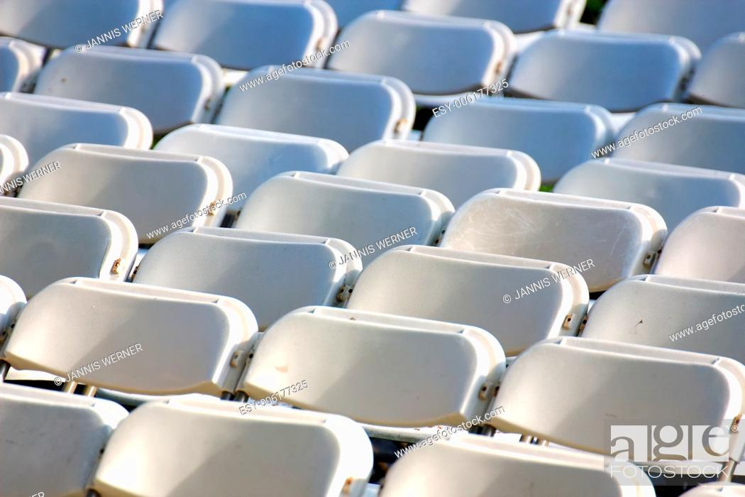 Stock Photo: Row upon row of empty chairs waiting for the audience at a university graduation ceremony.