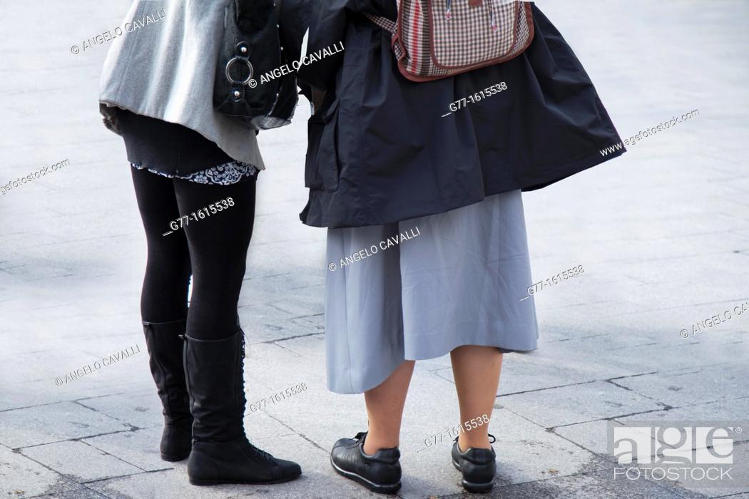 Stock Photo: Nun and young lady in Plaza Mayor, Madrid, Spain.