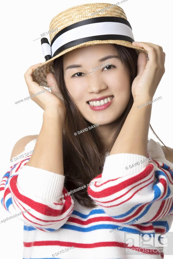 Stock Photo: Portrait of a Beautiful Chinese American woman displaying a bit of attitude isolated on a white background.