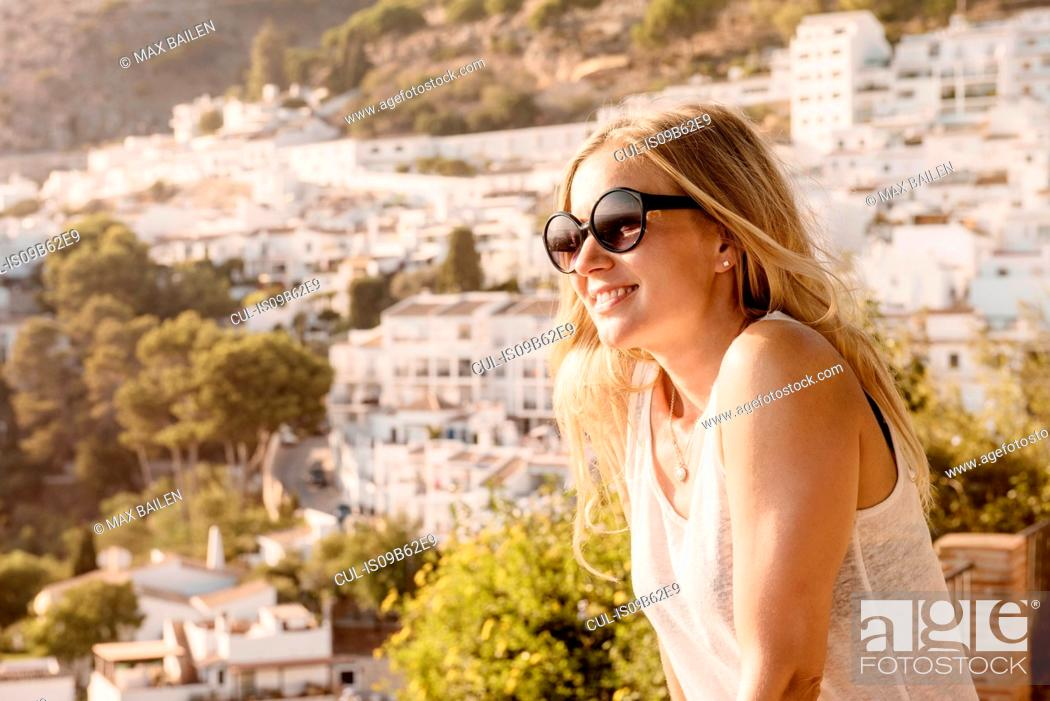 Stock Photo: Woman on viewing platform overlooking town, Mijas Pueblo, Andalucia, Spain.