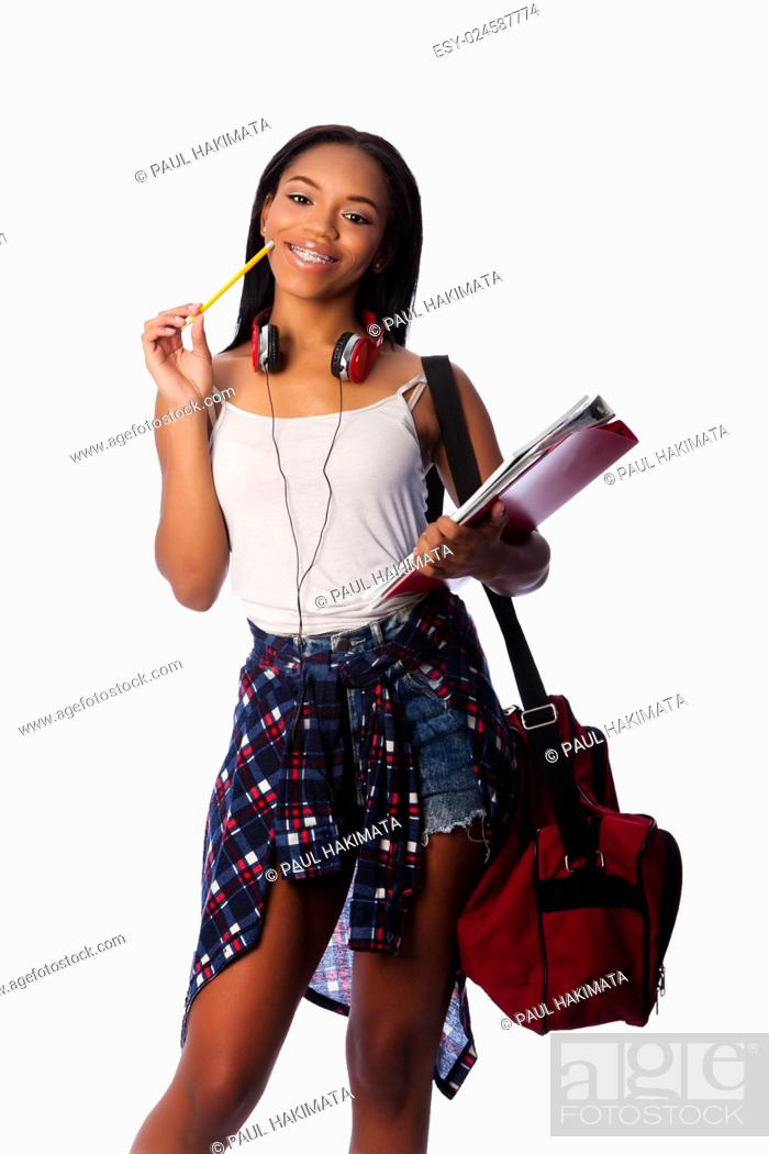 Stock Photo: Beautiful happy smiling student standing thinking with pencil and notepad binders coming up with ideas, on white.