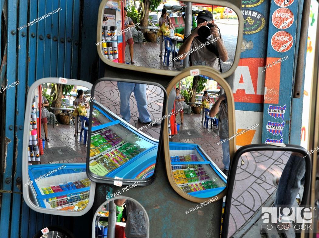 Stock Photo: mirrors , reflection, portrait  Photographer taking a weird photo, chinatown , bangkok, thailand.