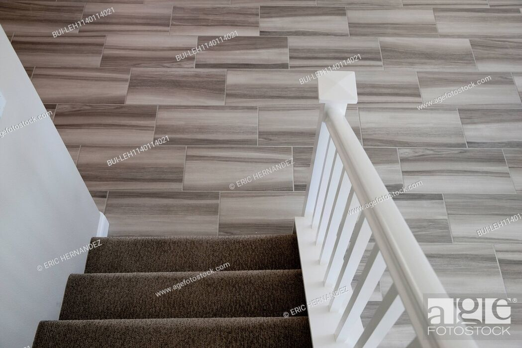 Imagen: Close-up of stairs with tiled floor at home.