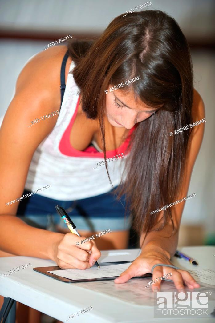 Stock Photo: Female doctor's assistant, 23 years old, caucasian, filling out paper work at a provisional vet clinic, Leakey, Texas, USA.