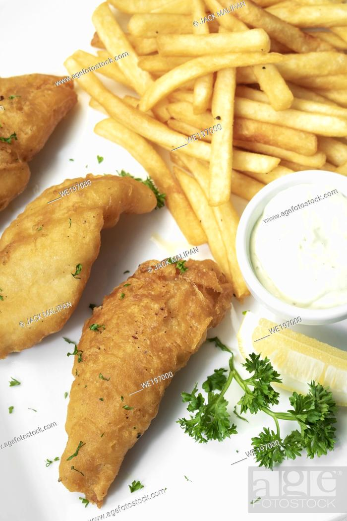 Stock Photo: british traditional fish and chips meal on white plate.
