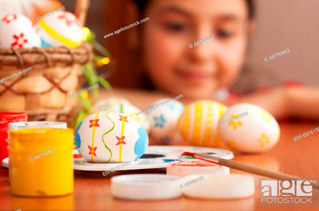 Stock Photo: Little girl looking for Easter eggs.