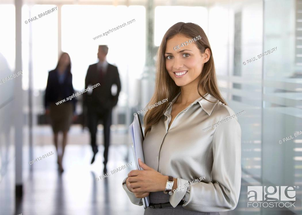 Stock Photo: Businesswoman smiling in office.