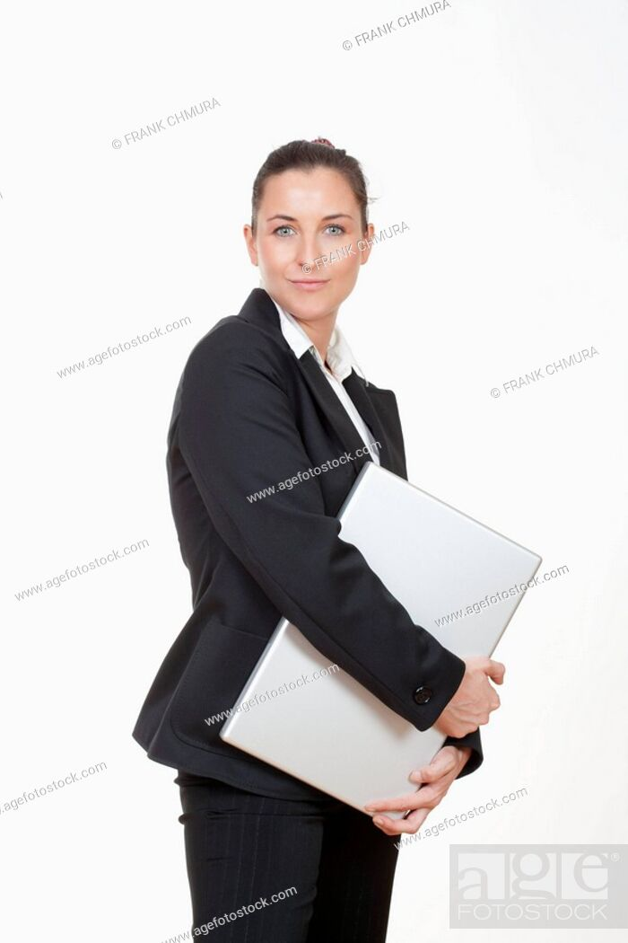 Stock Photo: Attractive businesswoman with laptop computer smiling.