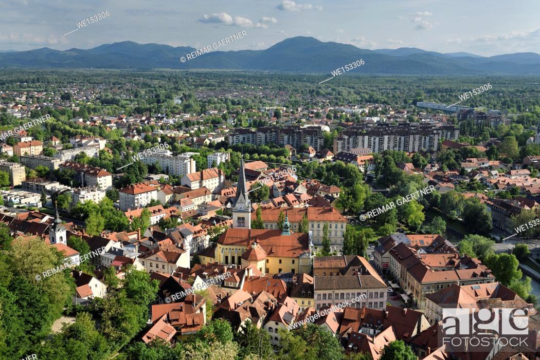 Stock Photo: Ljubljana capital city of Slovenia with the Karawanks Alps foothills former marsh land and St James's Catholic church from Ljubljana Castle Hill.