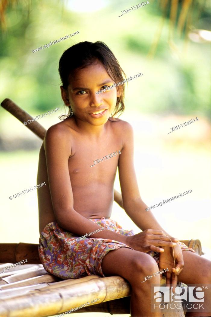 Stock Photo: little girl in Tossi, Sumba island, Lesser Sunda Islands, Republic of Indonesia, Southeast Asia and Oceania.