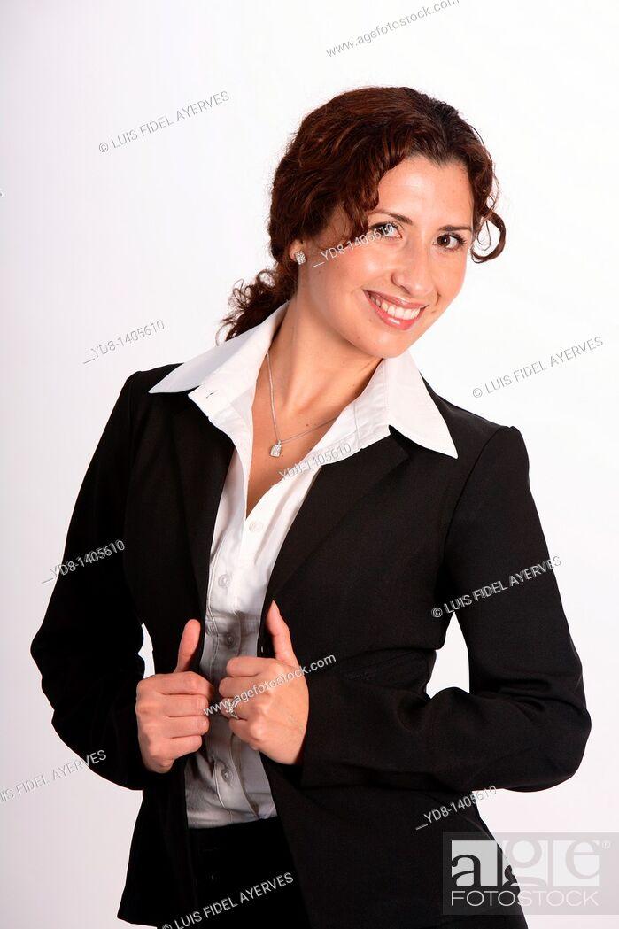 Stock Photo: Young woman posing in the studio as an executive.