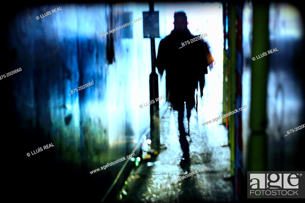 Stock Photo Silhouette Of A Person Moving Through Passage In East London England