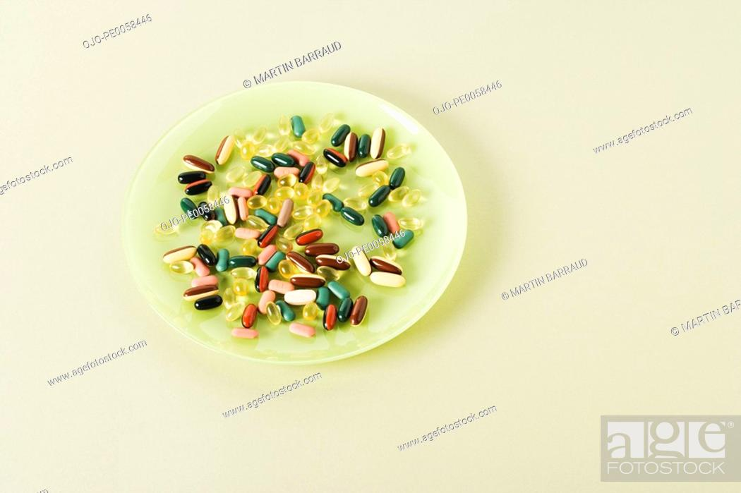 Stock Photo: A plate with pills on it.