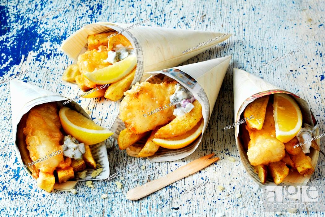 Stock Photo: Still life with fish and chips in cones.