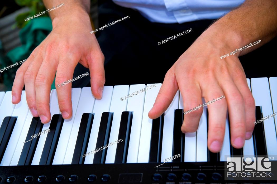 Stock Photo: Hands playing piano.