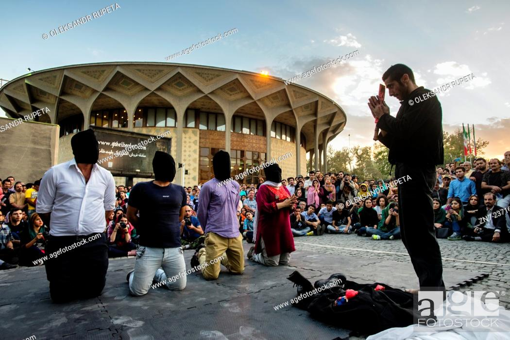 Stock Photo: Tanahang – body + music performance against ISIL terrorism by pianist Hanibal Yusef and dancer Yasser Khaseb in City Theater in Tehran, Iran.