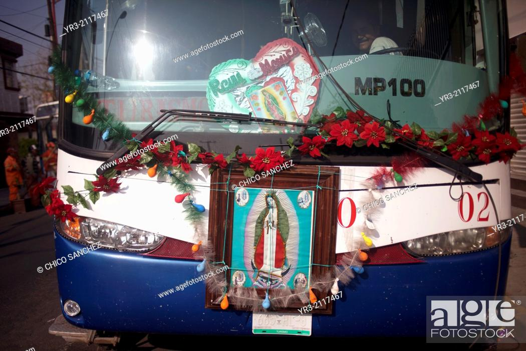 Stock Photo: Images of the Virgin of Guadalupe decorate a truck at the pilgrimage to Our Lady of Guadalupe Basilica in Mexico City, Mexico, December 11, 2013.