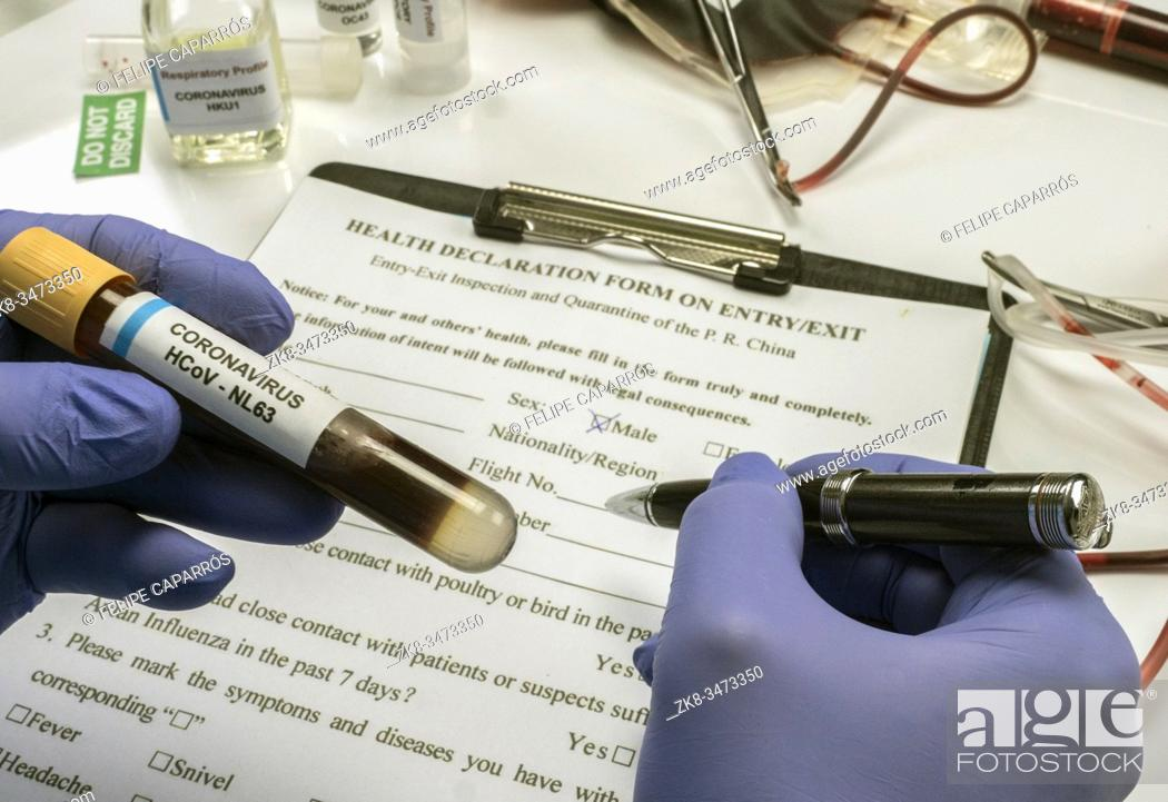 Stock Photo: Scientist examines sample of coronavirus in laboratory, conceptual image.