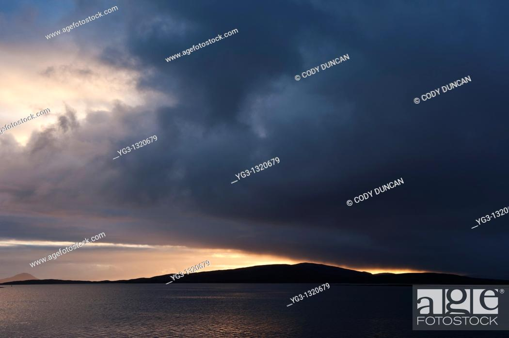 Stock Photo: Sunset over Sound of Berneray and North Uist, Western Isles, Scotland.
