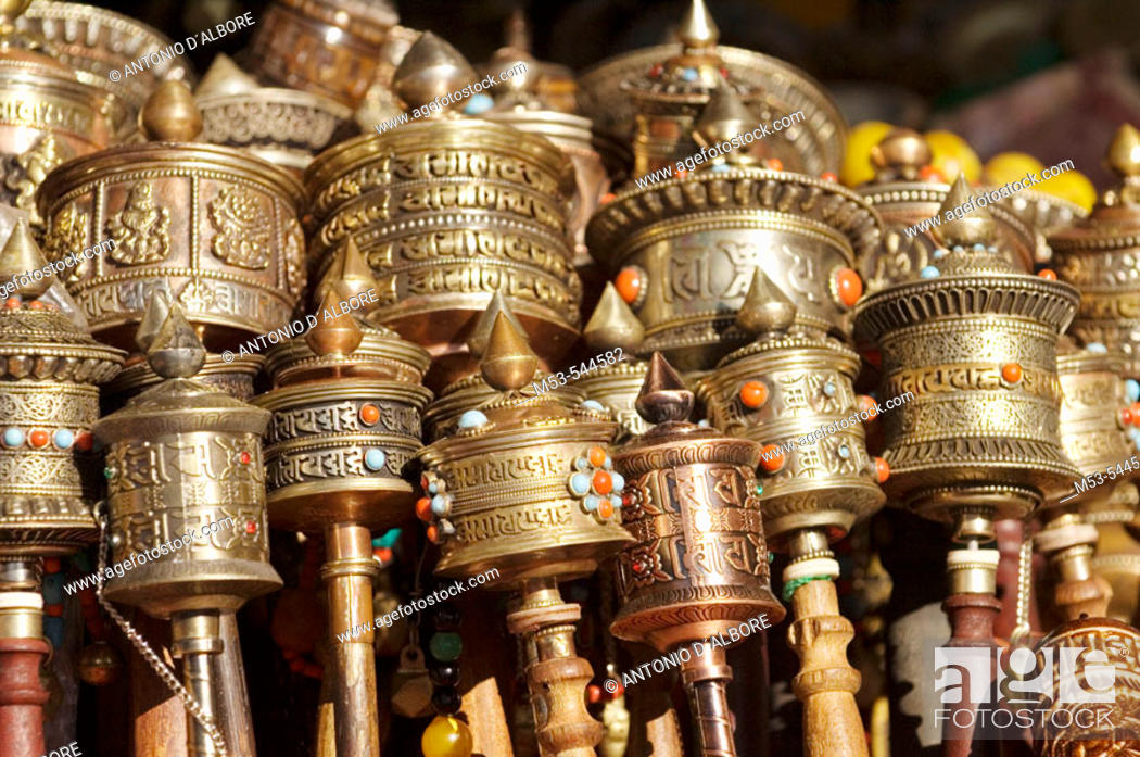 Stock Photo: tibetan pray wheels on sale on a stall. lhasa. lhasa prefecture. tibet. china. asia.