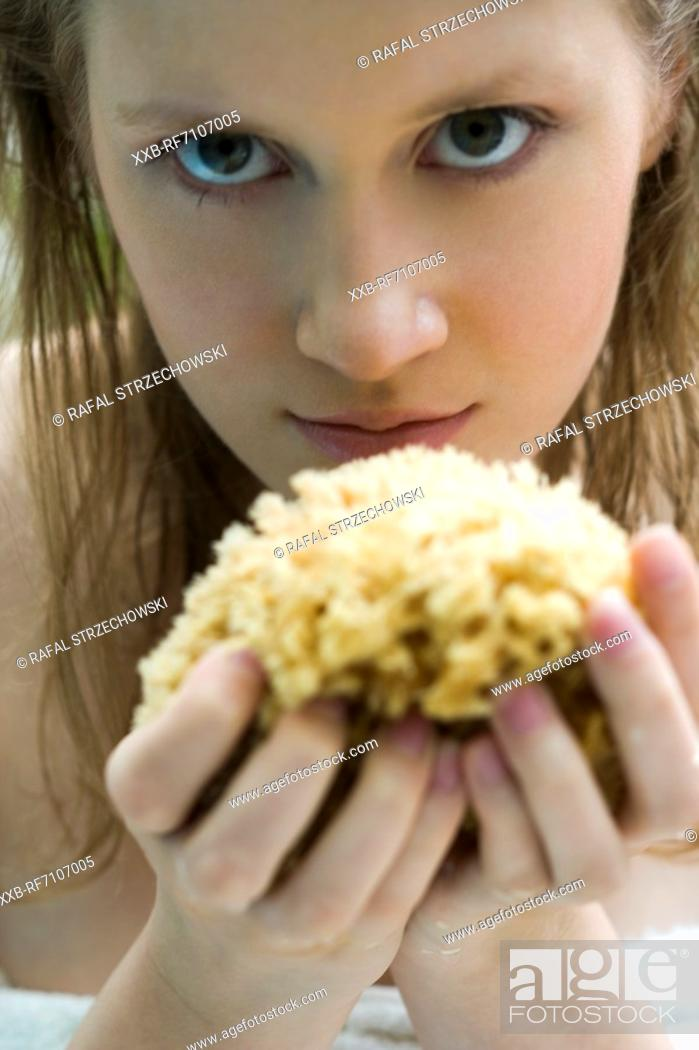 Stock Photo: Young woman with flowers.