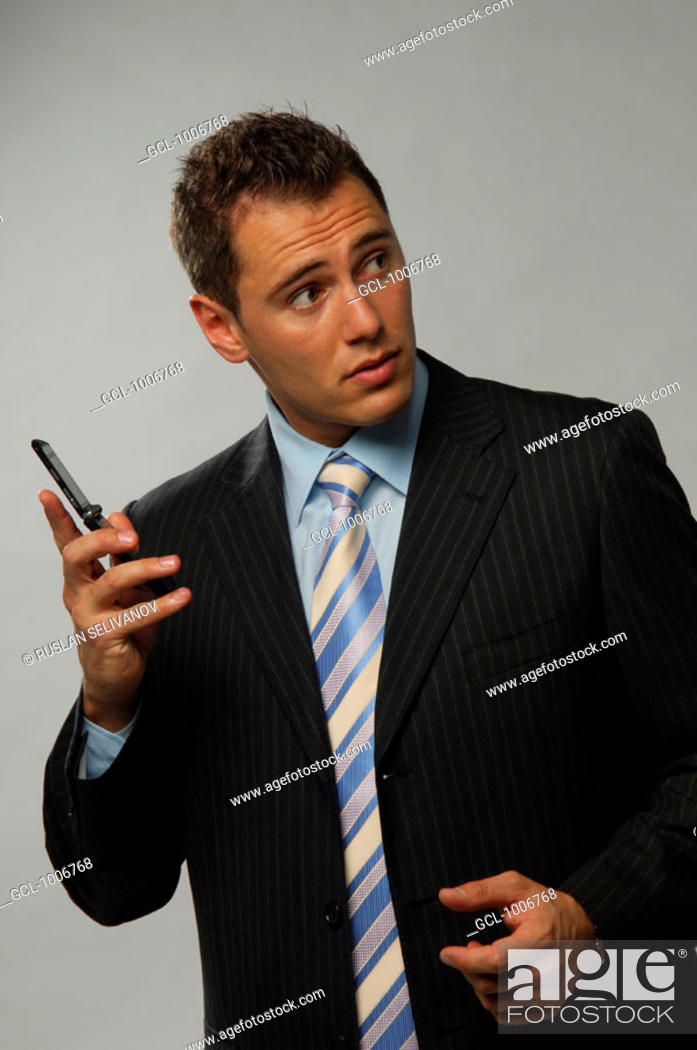 Stock Photo: Businessman holding mobile phone in his hand.