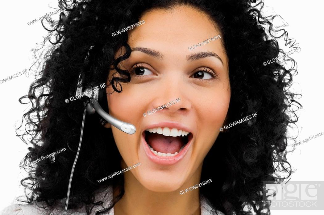 Stock Photo: Close-up of a female customer service representative wearing a headset.