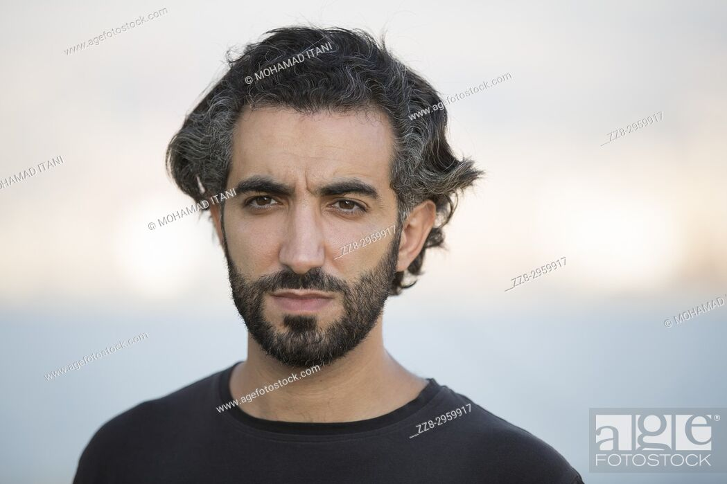 Stock Photo: Portrait of a Middle Eastern man outdoors.
