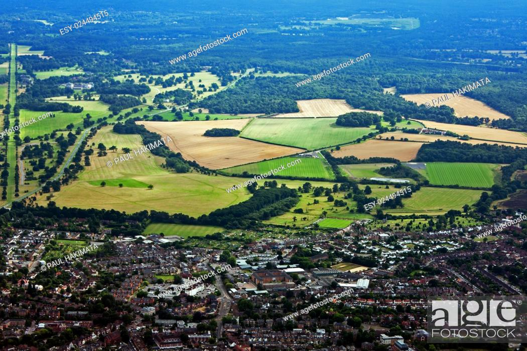 Stock Photo: Aerial view of city town surrounded by farmland and forests.