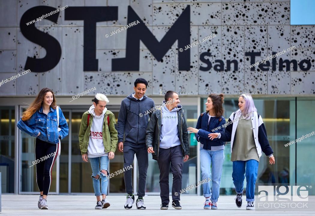 Stock Photo: Young people walking in Plaza Zuloaga, Exteriors of the San Telmo Museum, Donostia, San Sebastian, Gipuzkoa, Basque Country, Spain.
