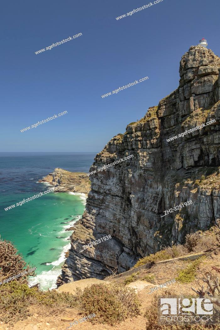 Stock Photo: View at Cape point with Cape of good hope, bushes and ocean, Cape point, South Africa.