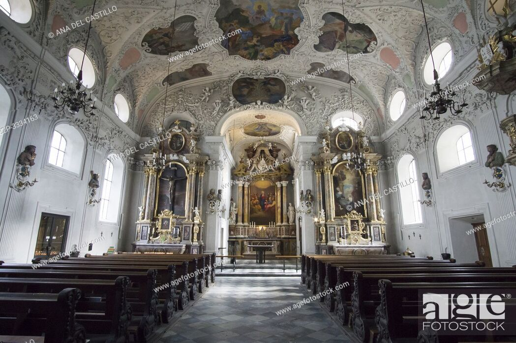 Stock Photo: Innsbruck city center Austria on April 16, 2019: Maria-Theresien-Strasse Hospital Church of the Holy Spirit.