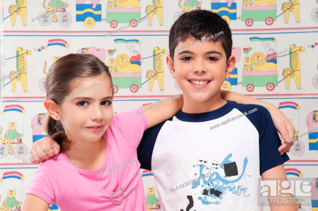 Stock Photo: Portrait of a boy and girl smiling with arm around.