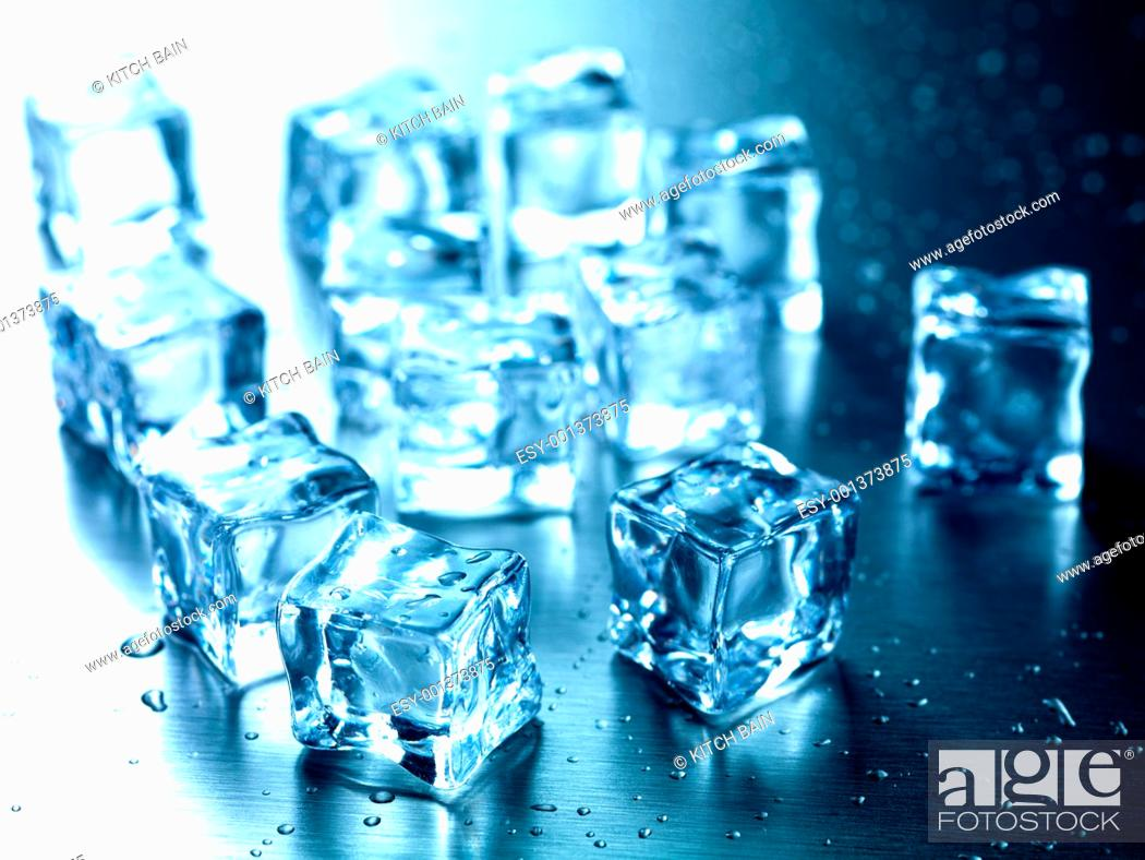 Stock Photo: Frozen ice cubes isolated on a kitchen bench.