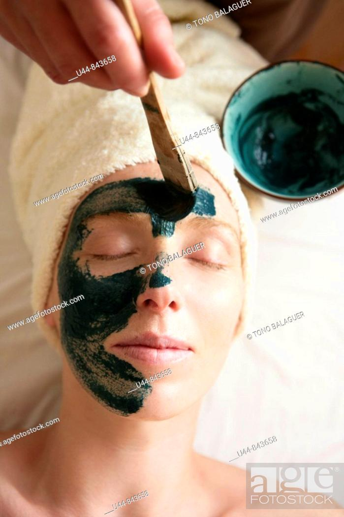 Stock Photo: Green clay face skin theraphy massage, woman.