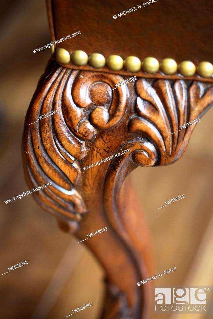 Stock Photo: Ornate wood carving detail of leg of chair.