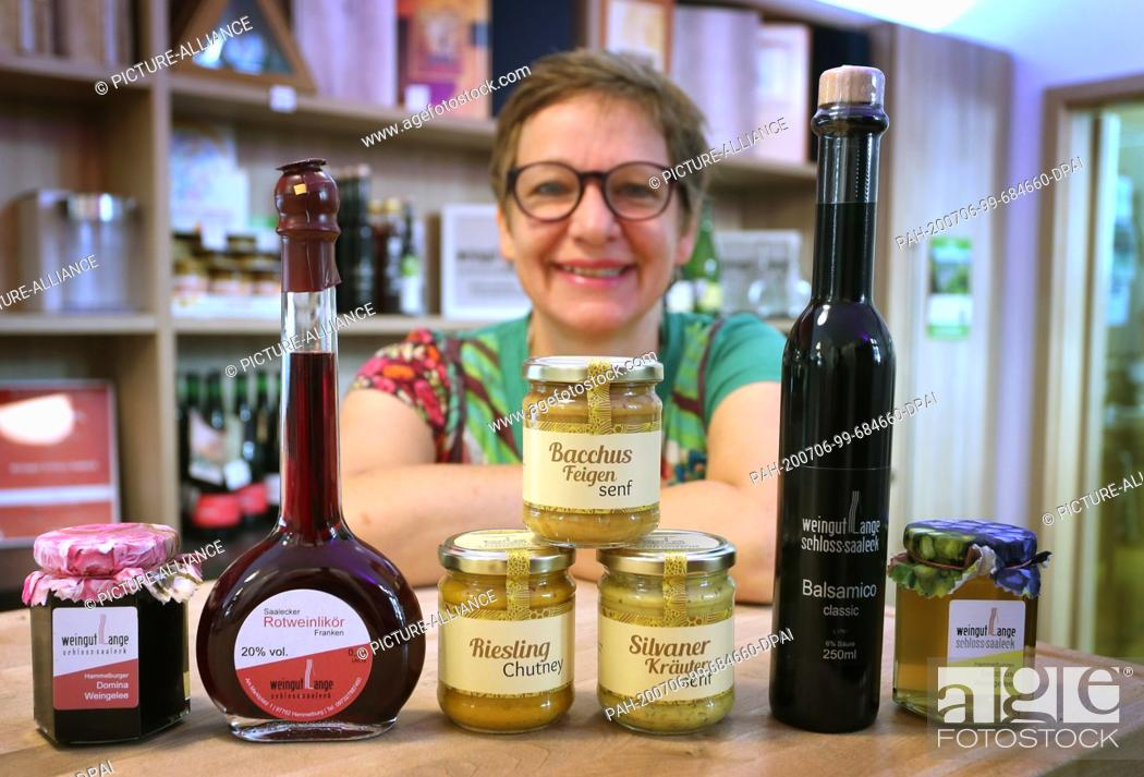 """Stock Photo: 12 June 2020, Bavaria, Hammelburg: Ulrike Lange, winemaker, presents several of her products made with Franconian wine (to dpa: """"""""Sausage."""