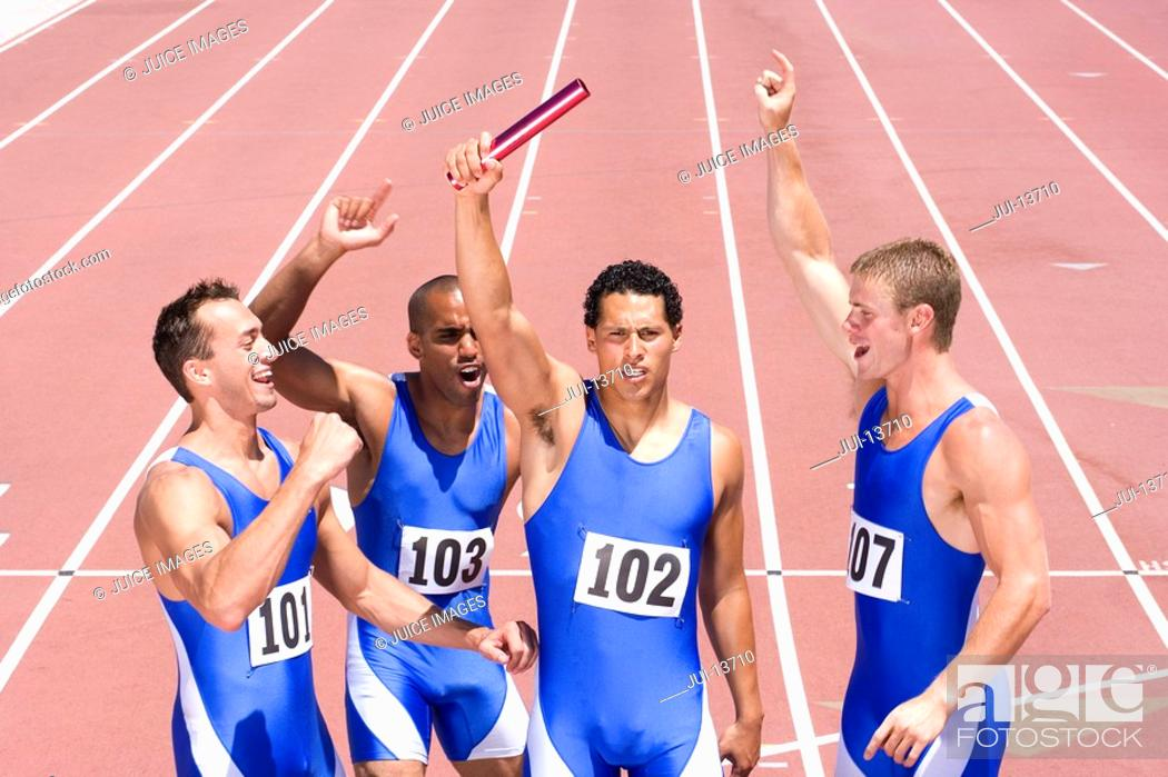 Stock Photo: Group of male athletes with arms raised in celebration, elevated view.